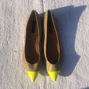 Tan color flats with a yellow toe